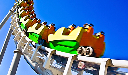 image of riders on a rollercoaster
