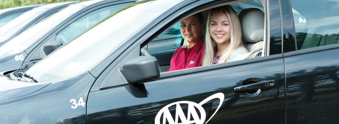 Driving student sitting in car with training instructor in passenger side